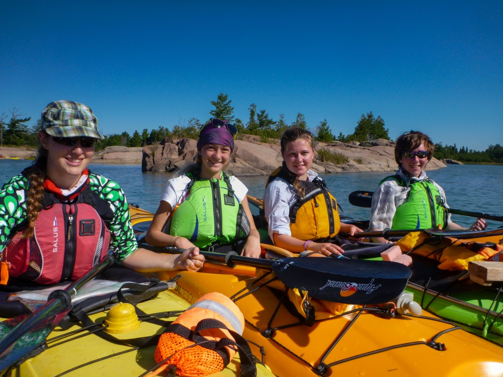 Youth on a sea kayak trip at White Squall Paddling Centre