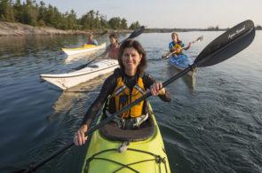 Group photo of women in sea kayaks.