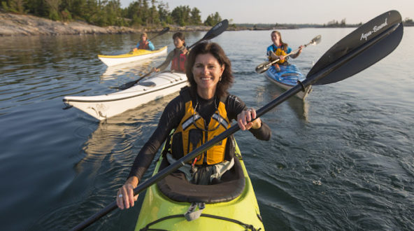 Group photo of women in sea kayaks.