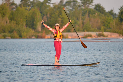 Student excited to be on a SUP board at White Squall Paddling Centre