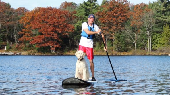 Tim Dyer and dog on a SUP board at White Squall Paddling Centre