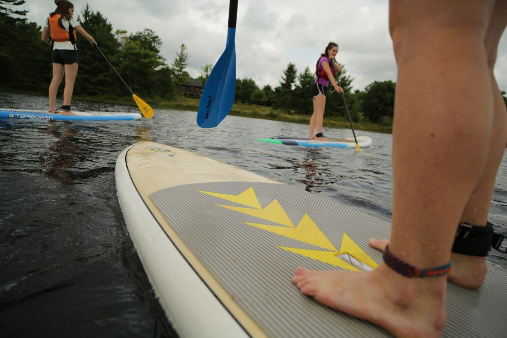 Women adults out on SUP boards at White Squall Paddling Centre