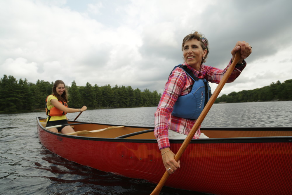 Two staff in canoes at White Squall Paddling Centre