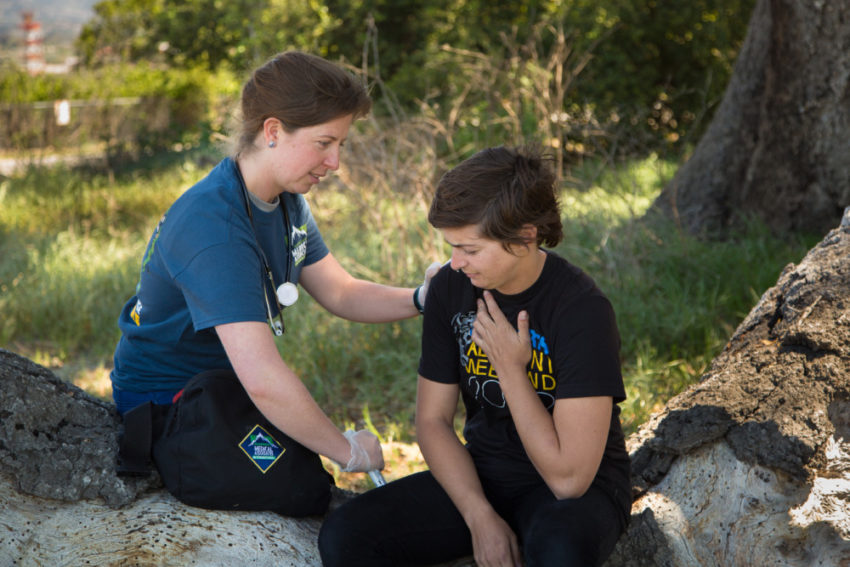 Student getting help on a Wilderness First Aid Class at White Squall