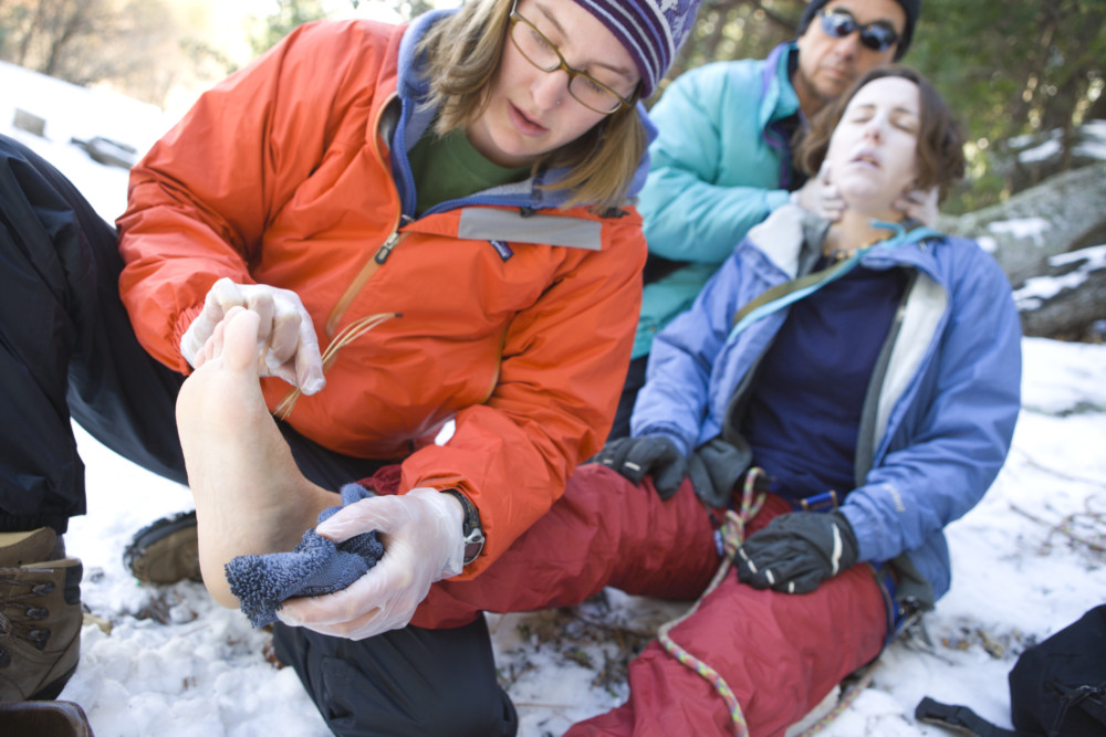 Student getting treated on a wilderness first aid course at White Squall Paddling Centre