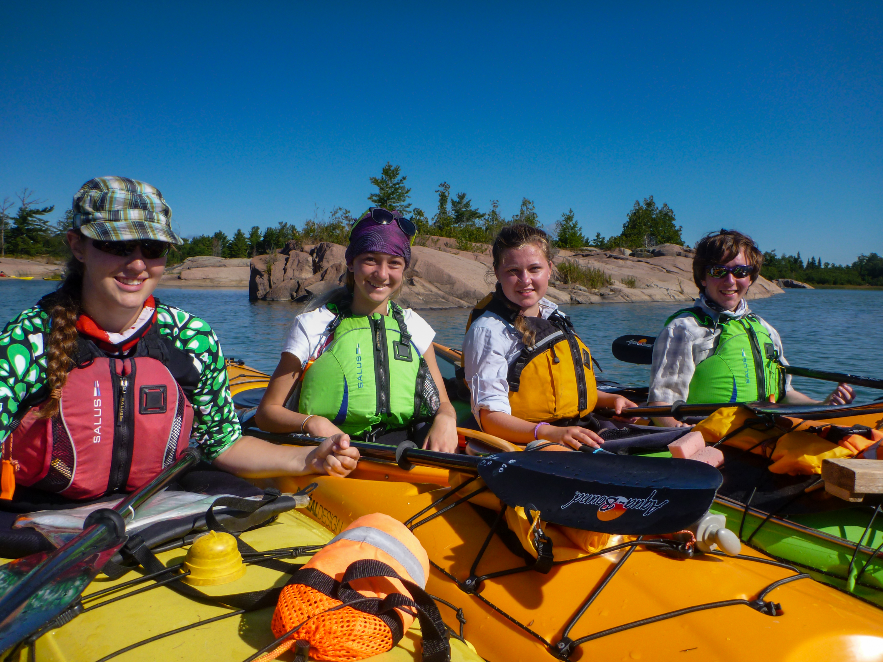 Teens in a kayak on Georgian Bay at White Squall Paddling Centre